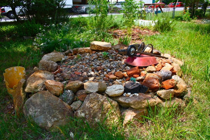 Stone Pile With Wheelbarrow